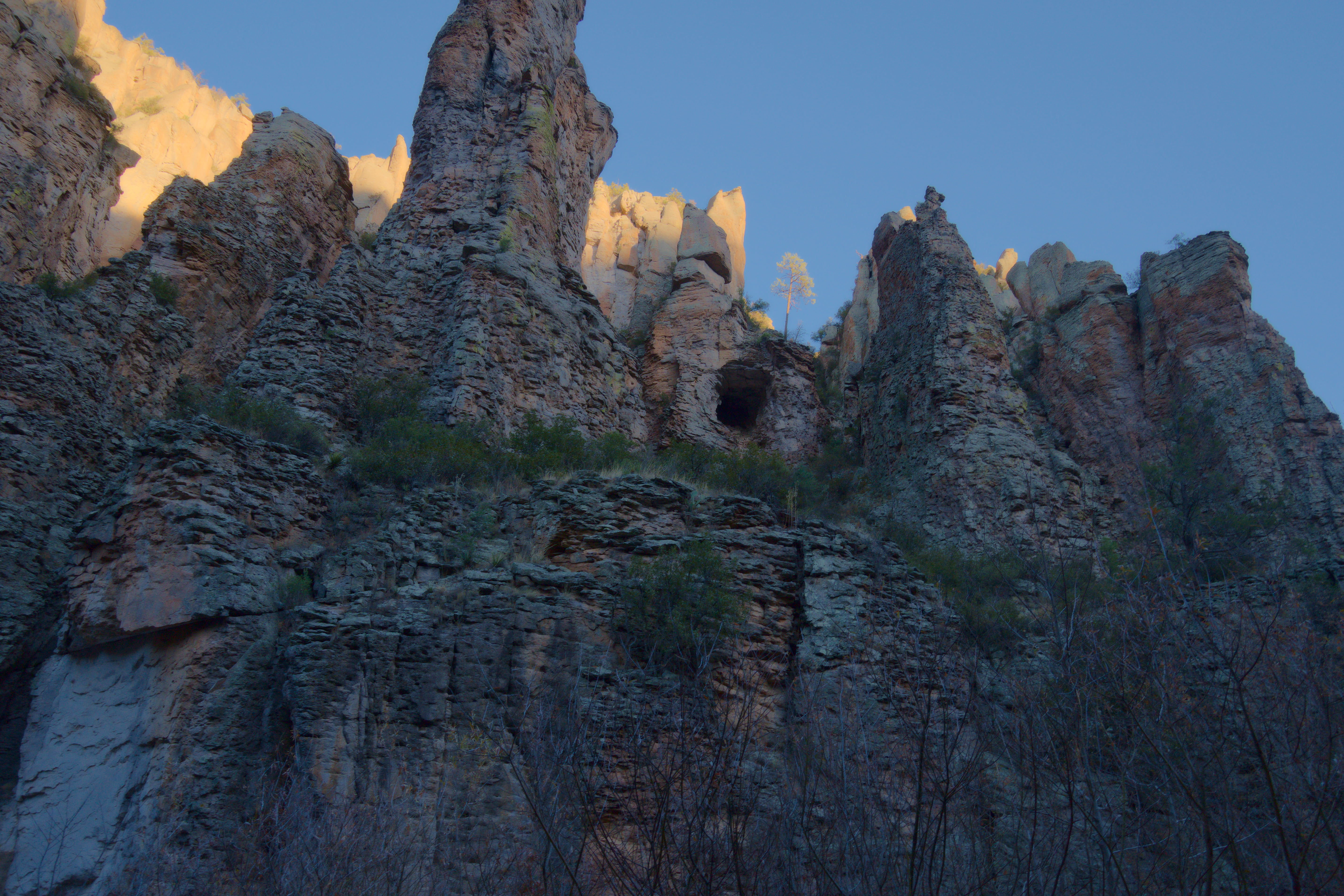 jagged cliffs overlooking the Gila River